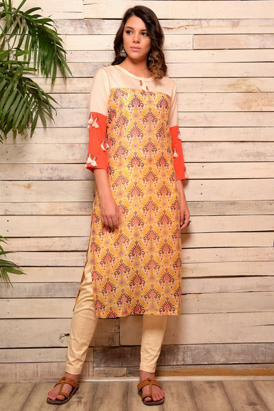 Buy yellow cotton silk kurta with tassel embellished sleeves and slim pants online in USA. Pick your favorite Indian designer suits and dresses from Pure Elegance clothing store in USA. Make your ethnic collection complete with a range of Indian sarees, Anarkali suits, designer lehengas also available on our online store.  -full view