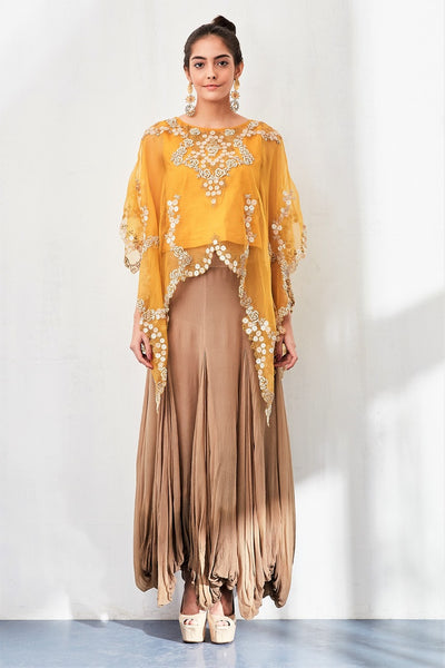 Buy mango yellow hand embroidered poncho with balloon skirt online in USA. Keep your style perfect with a stylish range of Indian designer clothes from Pure Elegance fashion store in USA. If you want to shop for Indian clothes online, then browse through our online store and shop at the comfort of your home.-full view