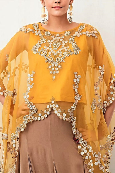 Buy mango yellow hand embroidered poncho with balloon skirt online in USA. Keep your style perfect with a stylish range of Indian designer clothes from Pure Elegance fashion store in USA. If you want to shop for Indian clothes online, then browse through our online store and shop at the comfort of your home.-poncho