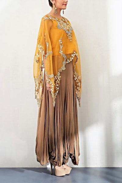 Buy mango yellow hand embroidered poncho with balloon skirt online in USA. Keep your style perfect with a stylish range of Indian designer clothes from Pure Elegance fashion store in USA. If you want to shop for Indian clothes online, then browse through our online store and shop at the comfort of your home.-side