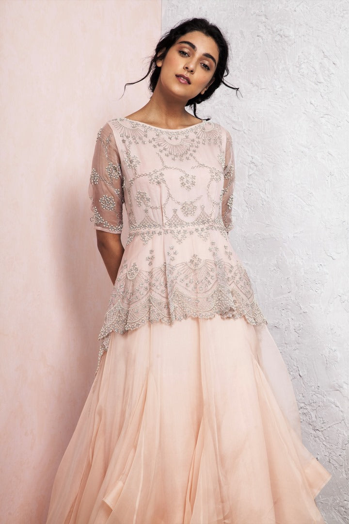 2234f5f94c13 Buy beautiful pink jewel embroidered peplum dress online in USA with  handkerchief hem. Keep your