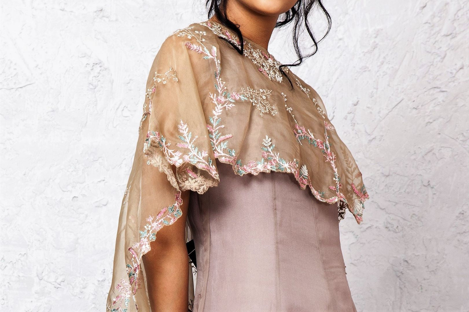 Buy grey embroidered hi-low circular cape & balloon dress online in USA. Keep your style perfect with a stylish range of Indian designer dresses from Pure Elegance fashion store in USA. If you want to shop for modern Indian clothing online, then browse through our online store and shop at the comfort of your home.-cape
