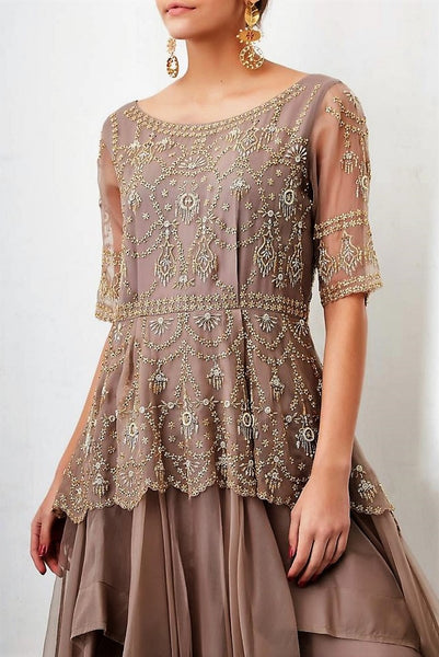 Shop designer grey embroidered peplum chiffon long dress online in USA. Keep your style perfect with a stylish range of Indian designer dresses from Pure Elegance fashion store in USA. If you want to shop for modern Indian clothing online, then browse through our online store and shop at the comfort of your home.-top
