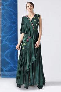 Shop bottle green embroidered layered frills gown online in USA at Pure Elegance. Make your wardrobe an eclectic mix of alluring silhouettes and colors with a range of Indian designer clothes available at our clothing store in USA. -full view
