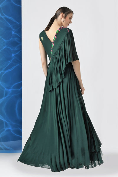 Shop bottle green embroidered layered frills gown online in USA at Pure Elegance. Make your wardrobe an eclectic mix of alluring silhouettes and colors with a range of Indian designer clothes available at our clothing store in USA. -back