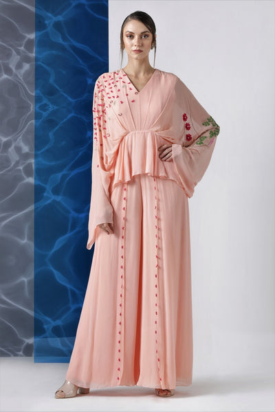 Buy powder pink embroidered jumpsuit with exaggerated sleeves online in USA from Pure Elegance. Make your wardrobe an eclectic mix of alluring silhouettes and colors with a range of Indian designer clothes available at our clothing store in USA. -full view