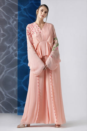 Buy powder pink embroidered jumpsuit with exaggerated sleeves online in USA from Pure Elegance. Make your wardrobe an eclectic mix of alluring silhouettes and colors with a range of Indian designer clothes available at our clothing store in USA. -front