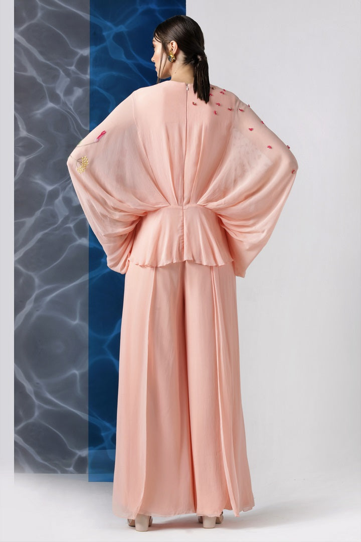 Buy powder pink embroidered jumpsuit with exaggerated sleeves online in USA from Pure Elegance. Make your wardrobe an eclectic mix of alluring silhouettes and colors with a range of Indian designer clothes available at our clothing store in USA. -back