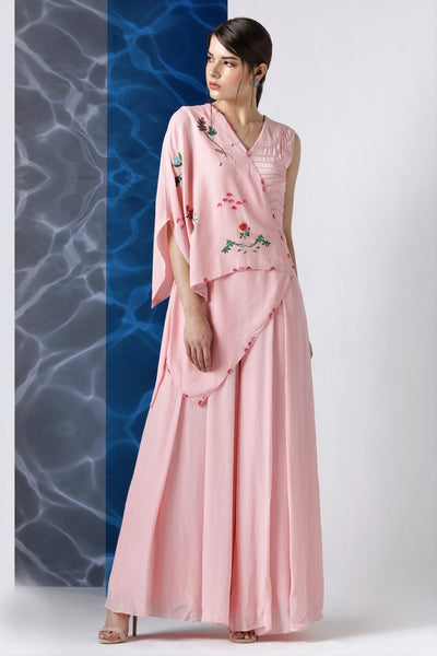 Buy powder pink embroidered jumpsuit with one shoulder drape online in USA at Pure Elegance. Make your wardrobe an eclectic mix of alluring silhouettes and colors with a range of Indian designer clothes available at our clothing store in USA. -full view