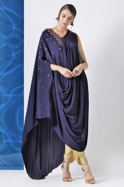 Shop navy embroidered draped crepe kurta with dhoti pants online in USA at Pure Elegance. Make your wardrobe an eclectic mix of alluring silhouettes and colors with a range of Indian designer clothes available at our clothing store in USA. -full view