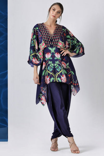 Shop navy printed kaftaan style tunic with dhoti pants online in USA from Pure Elegance. Make your wardrobe an eclectic mix of alluring silhouettes and colors with a range of Indian designer clothes available at our clothing store in USA. -full view