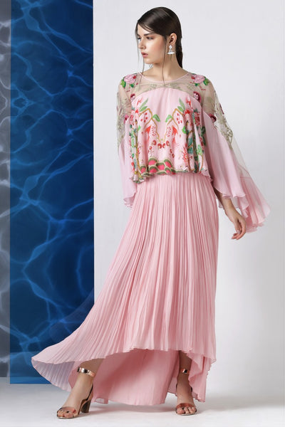 Shop pink embroidered top with asymmetric pleated skirt online in USA from Pure Elegance. Make your wardrobe an eclectic mix of alluring silhouettes and colors with a range of Indian designer clothes available at our clothing store in USA. -full view