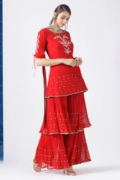 Buy red embroidered kurta with layered kurta with pleated dupatta online in USA from Pure Elegance. Make your wardrobe an eclectic mix of alluring silhouettes and colors with a range of Indian designer clothes available at our clothing store in USA. -full view