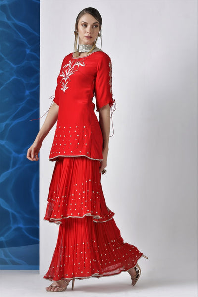 Buy red embroidered kurta with layered kurta with pleated dupatta online in USA from Pure Elegance. Make your wardrobe an eclectic mix of alluring silhouettes and colors with a range of Indian designer clothes available at our clothing store in USA. -side