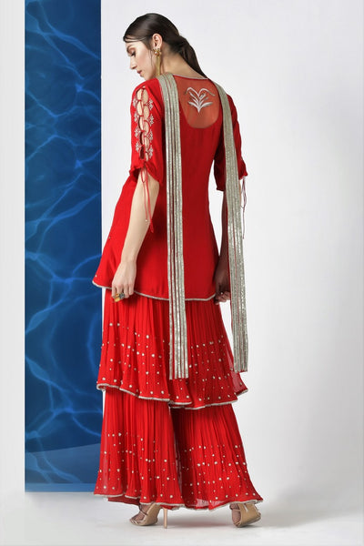 Buy red embroidered kurta with layered kurta with pleated dupatta online in USA from Pure Elegance. Make your wardrobe an eclectic mix of alluring silhouettes and colors with a range of Indian designer clothes available at our clothing store in USA. -back