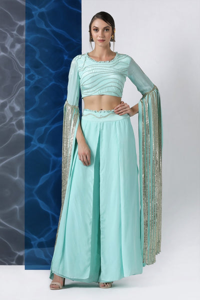 Buy mint embroidered crop top with exaggerated sleeves and palazzo online in USA at Pure Elegance. Make your wardrobe an eclectic mix of alluring silhouettes and colors with a range of Indian designer clothes available at our clothing store in USA. -front