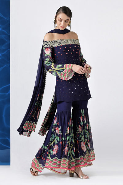 Buy navy embroidered off shoulder kurti with sharara and dupatta online in USA from Pure Elegance. Make your wardrobe an eclectic mix of alluring silhouettes and colors with a range of Indian designer clothing available at our clothing store in USA. -full view