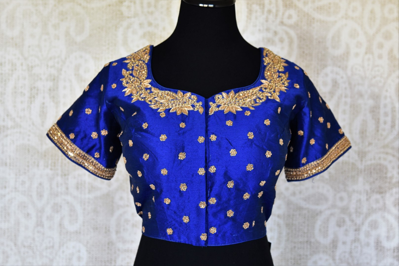 Shop blue raw silk embroidered saree blouse online in USA. Complete your saree look with exquisite designer saree blouses from Pure Elegance Indian clothing store in USA. -front