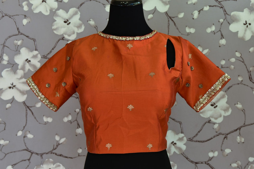 Shop rust orange embroidered Banarasi saree blouse online in USA. Score a perfect ten for your saree look with exquisite designer saree blouses from Pure Elegance Indian fashion store in USA. Shop now.-front