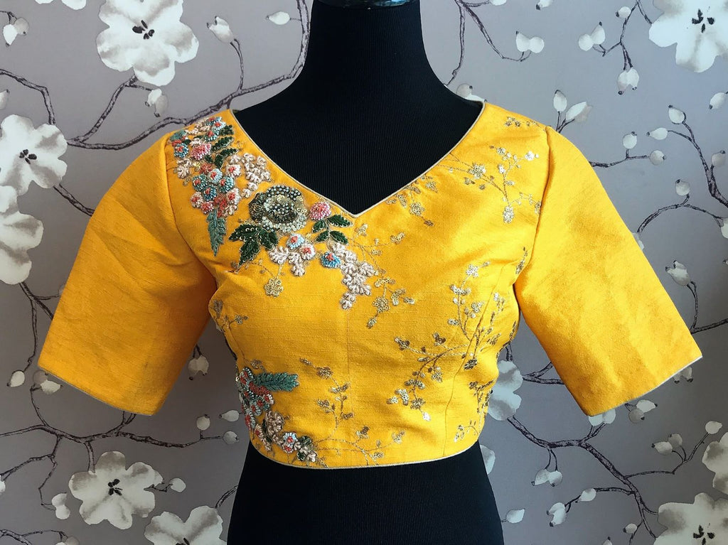 Buy yellow embroidered designer silk saree blouse online in USA. Enhance your traditional saree look with a splendid range of designer sari blouses from Pure Elegance Indian fashion store in USA.-front