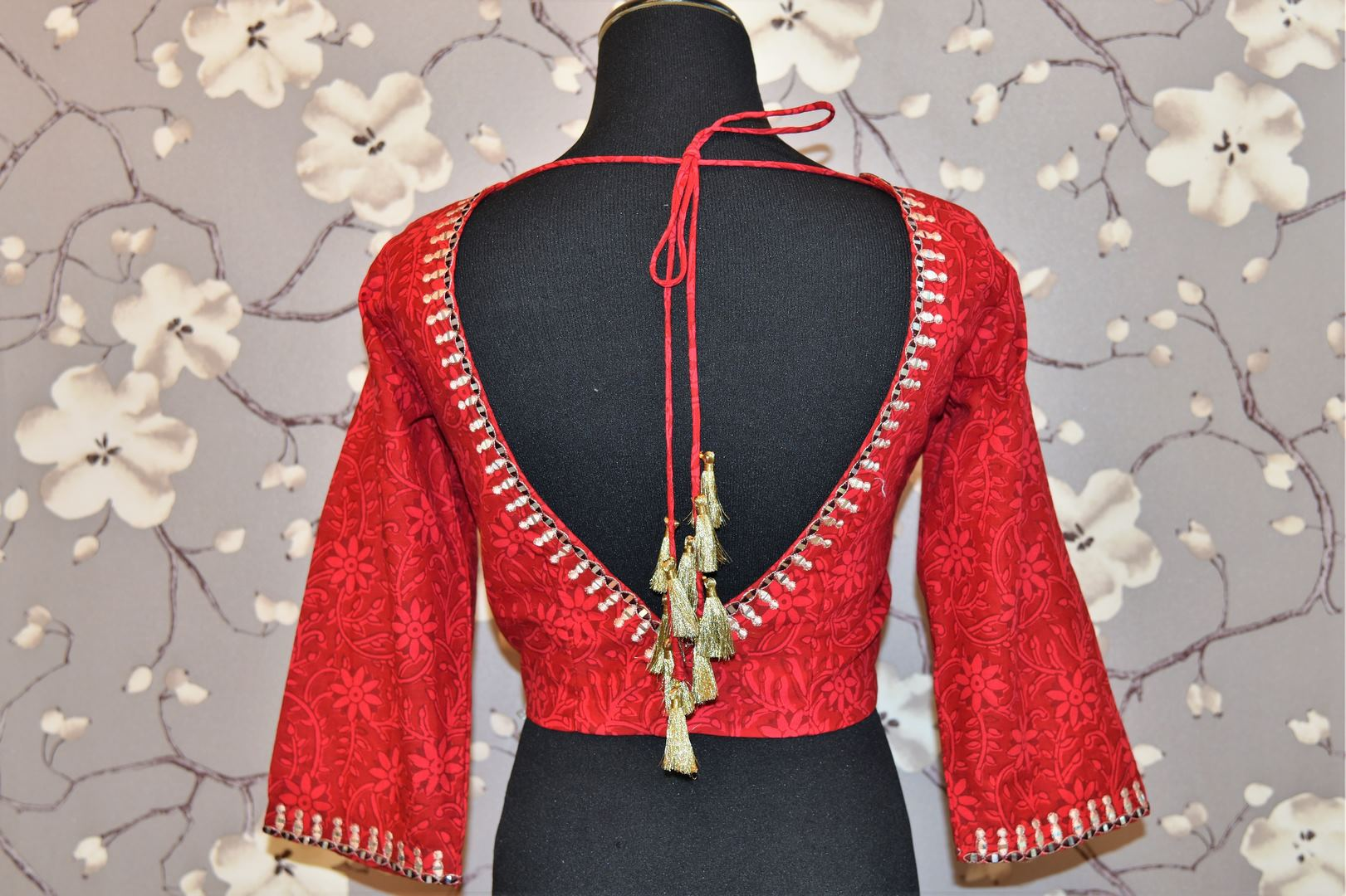Buy red block print and embroidered saree blouse online in USA. Enhance your traditional saree look with a splendid range of designer saree blouses from Pure Elegance Indian fashion store in USA.-back