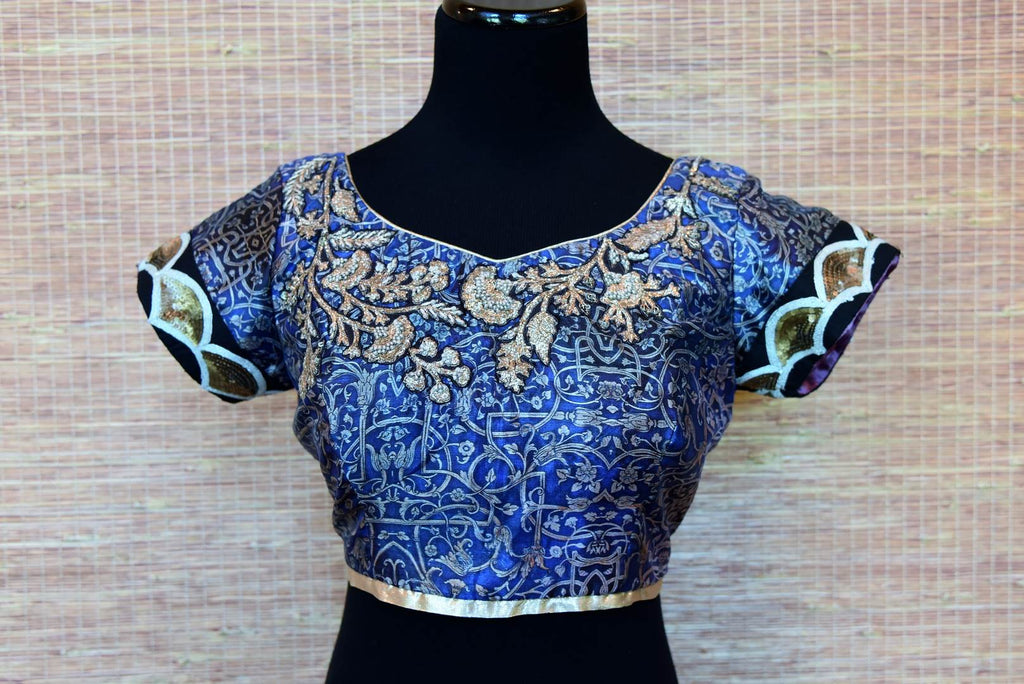 Shop blue printed and embroidered silk saree blouse online in USA. Elevate your ethnic saree style with a tasteful collection of designer saree blouses from Pure Elegance Indian clothing store in USA.-front