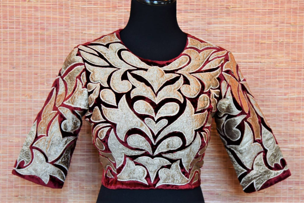 Shop designer maroon applique work velvet saree blouse online in USA. Highlight your beautiful sarees with gorgeous designer sarees blouses, readymade saree blouses from Pure Elegance Indian clothing store in USA.-front