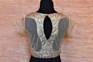 Buy beige sequin work net designer saree blouse online in USA. Highlight your beautiful sarees with gorgeous designer sarees blouses, readymade saree blouses from Pure Elegance Indian clothing store in USA.-back