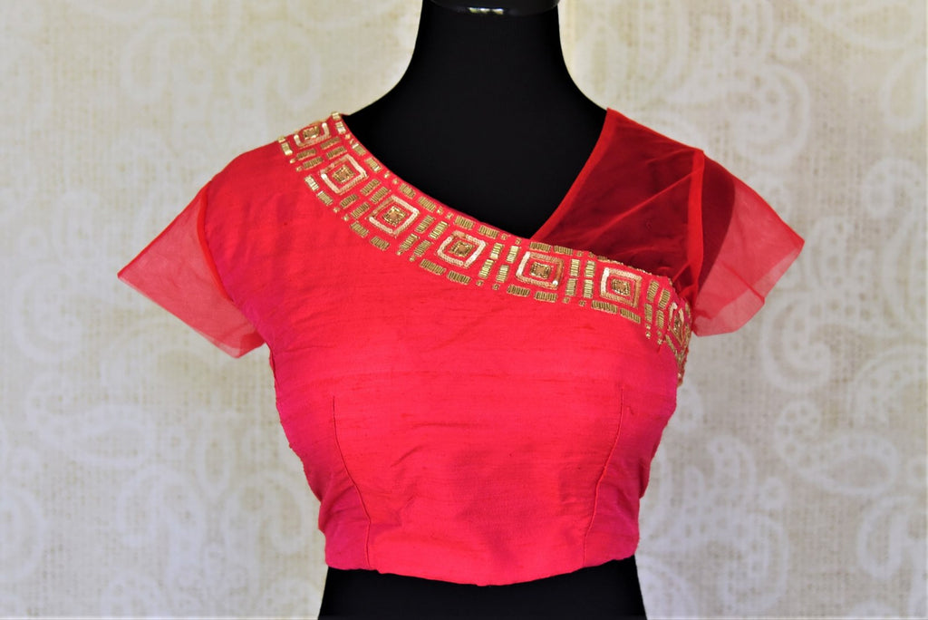 Buy contemporary red hand embroidered silk saree blouse online in USA with one sheer sleeve. Elevate your handwoven sarees with this beautiful readymade saree blouses from Pure Elegance Indian clothing store in USA.-front