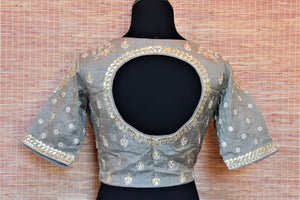 Shop gorgeous grey tissue silk saree blouse online in USA with gota and pearl embroidery. Highlight your beautiful sarees with gorgeous designer sari blouses, readymade saree blouses from Pure Elegance Indian clothing store in USA.-back