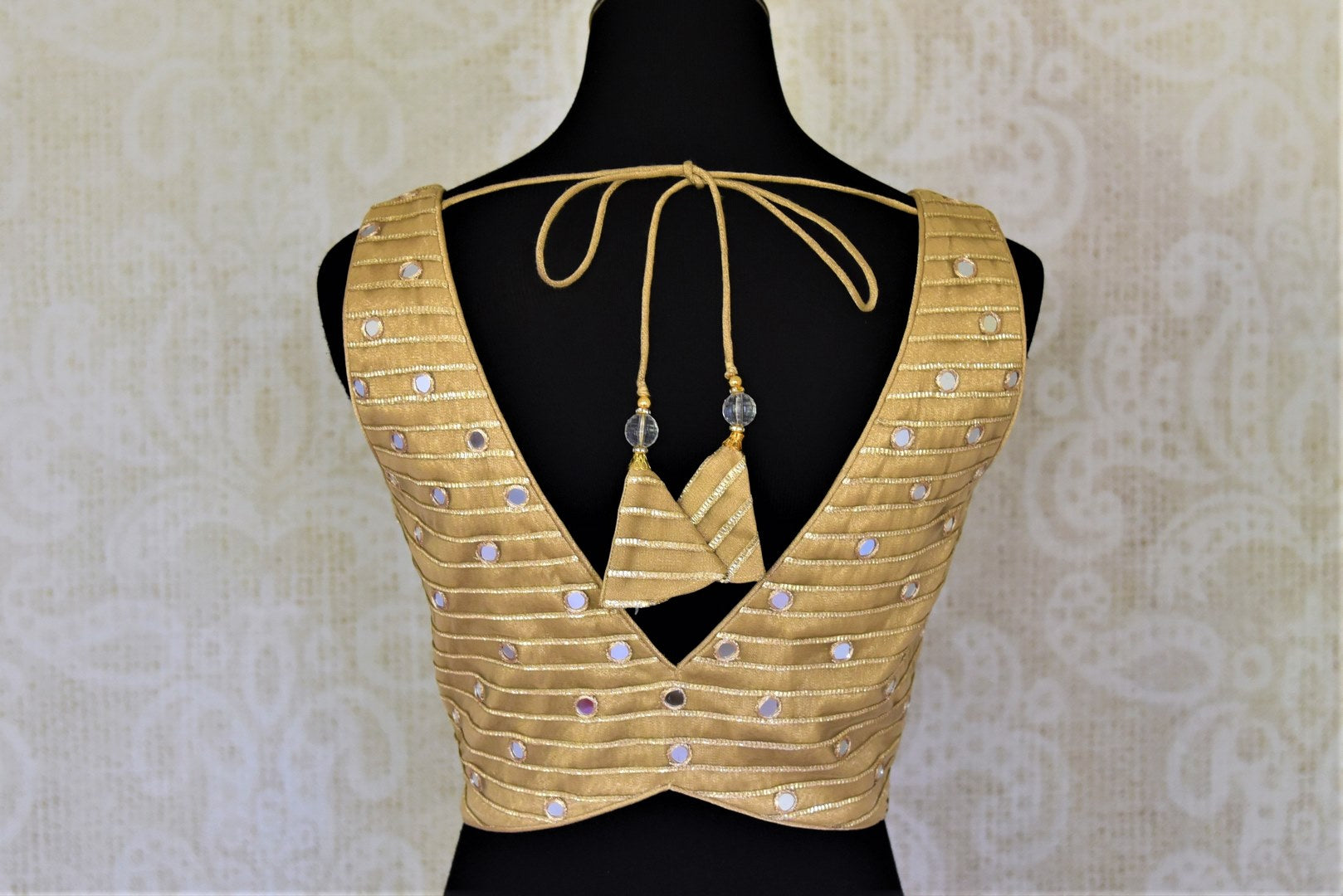 Shop golden net sleeveless saree blouse online in USA with mirror work. Elevate your handwoven sarees with this beautiful readymade saree blouses from Pure Elegance Indian clothing store in USA.-back
