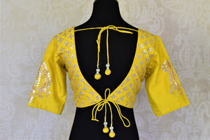 Shop bright yellow silk readymade gota patti saree blouse online in USA. Elevate your handwoven sarees with this beautiful readymade saree blouses from Pure Elegance Indian clothing store in USA.-back