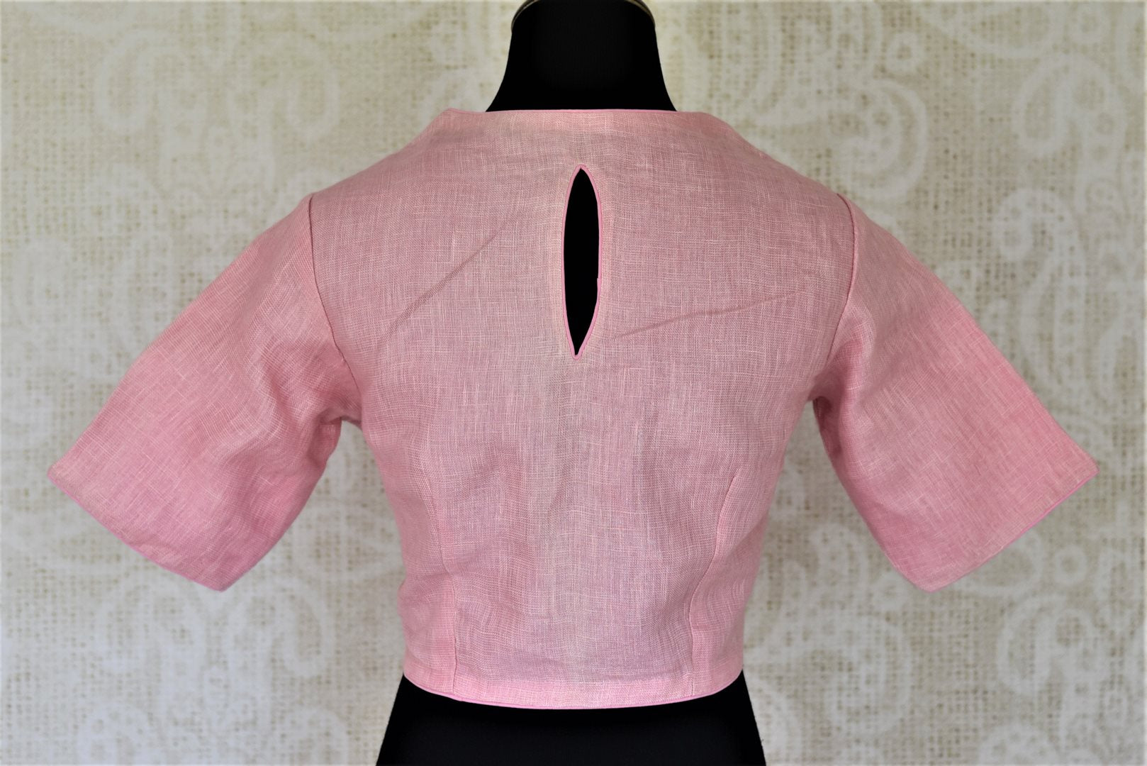 Shop stunning solid pink linen saree blouse online in USA. Complete your ethnic saree look with designer blouses, readymade sari blouse, embroidered saree blouse from Pure Elegance Indian saree store in USA.-back