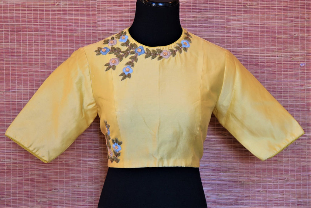 Shop lovely lemon yellow embroidered Banarasi saree blouse online in USA with cutout back. Complete your Indian sarees with exquisite readymade saree blouse from Pure Elegance Indian clothing store in USA.-front