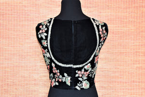 Shop ravishing black sleeveless embroidered velvet saree blouse online in USA. Complete your Indian sarees with exquisite readymade sari blouse from Pure Elegance Indian clothing store in USA.-back