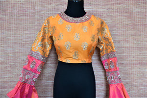 Shop beautiful yellow embroidered silk saree blouse online in USA with pink ruffle sleeves. Complete your Indian sarees with exquisite readymade sari blouse from Pure Elegance Indian clothing store in USA.-front