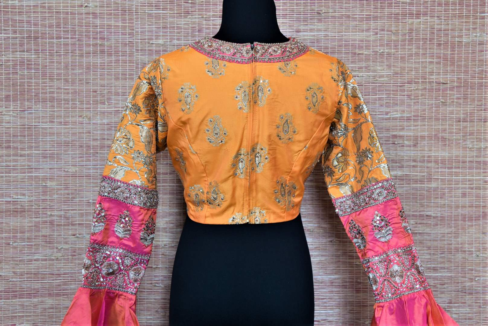 Shop beautiful yellow embroidered silk saree blouse online in USA with pink ruffle sleeves. Complete your Indian sarees with exquisite readymade sari blouse from Pure Elegance Indian clothing store in USA.-back