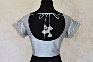 Buy beautiful light grey silk saree blouse online in USA with lace on sleeves. Complete your ethnic saree look with designer blouses, readymade sari blouse, embroidered saree blouse from Pure Elegance Indian saree store in USA.-back