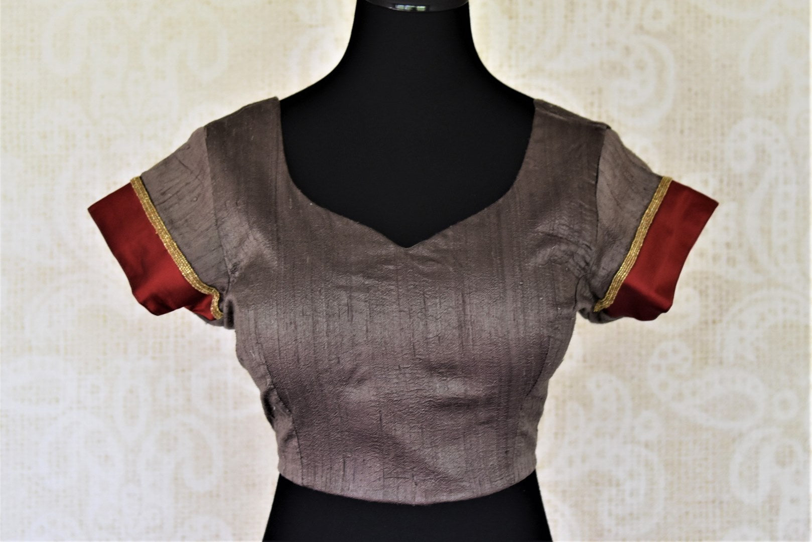 Shop dark grey silk sari saree blouse online in USA with red border on sleeves. Complete your ethnic saree look with designer blouses, readymade sari blouse, embroidered saree blouse from Pure Elegance Indian saree store in USA.-full view