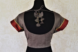 Shop dark grey silk sari saree blouse online in USA with red border on sleeves. Complete your ethnic saree look with designer blouses, readymade sari blouse, embroidered saree blouse from Pure Elegance Indian saree store in USA.-back