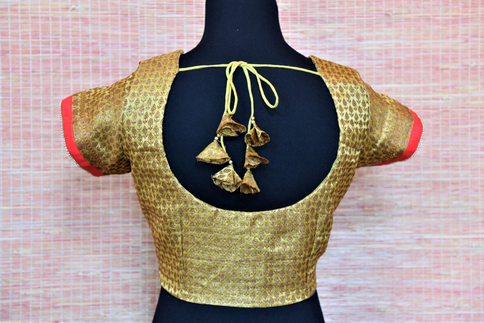 Buy beautiful golden embroidered Banarasi saree blouse online in USA. Complete your Indian sarees with exquisite readymade sari blouse from Pure Elegance Indian clothing store in USA.-back
