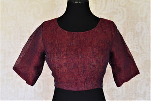 Shop elegant maroon designer linen saree blouse online in USA. Complete your ethnic saree look with designer blouses, readymade sari blouse, embroidered saree blouse from Pure Elegance Indian saree store in USA.-front