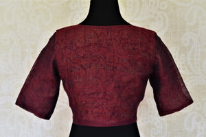 Shop elegant maroon designer linen saree blouse online in USA. Complete your ethnic saree look with designer blouses, readymade sari blouse, embroidered saree blouse from Pure Elegance Indian saree store in USA.-back