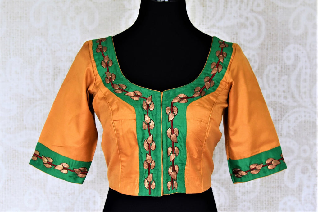 Shop beautiful orange and green embroidered silk saree blouse online in USA. Shop stunning readymade sari blouses, designer saree blouse, embroidered saree blouses for your Indian sarees from Pure Elegance Indian fashion boutique in USA.-front