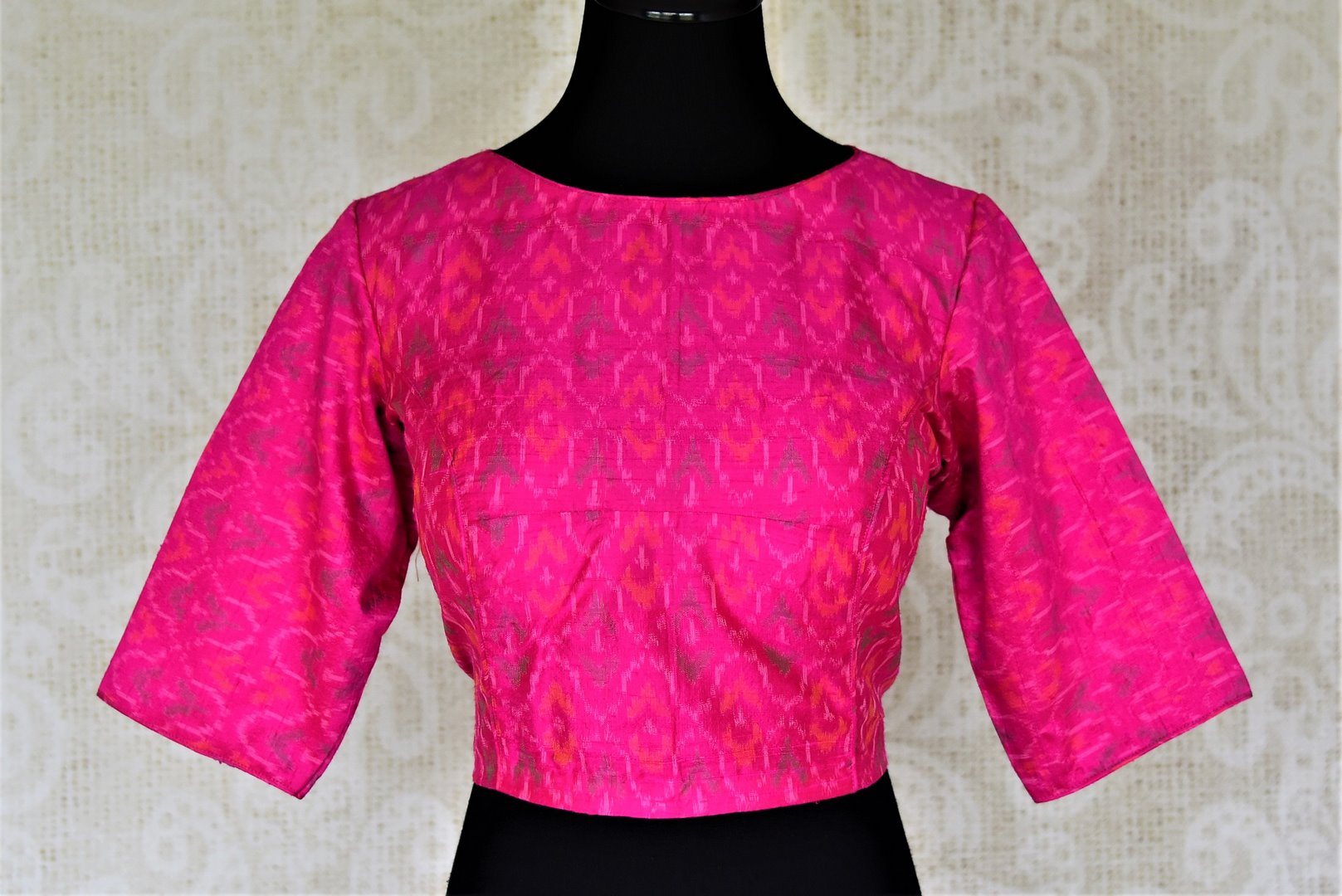 Buy bright fuschia pink ikat silk sari blouse online in USA with keyhole back design. Shop stunning readymade sari blouses, designer saree blouse, embroidered saree blouses for your Indian sarees from Pure Elegance Indian fashion boutique in USA.-front