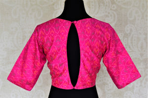 Buy bright fuschia pink ikat silk sari blouse online in USA with keyhole back design. Shop stunning readymade sari blouses, designer saree blouse, embroidered saree blouses for your Indian sarees from Pure Elegance Indian fashion boutique in USA.-back