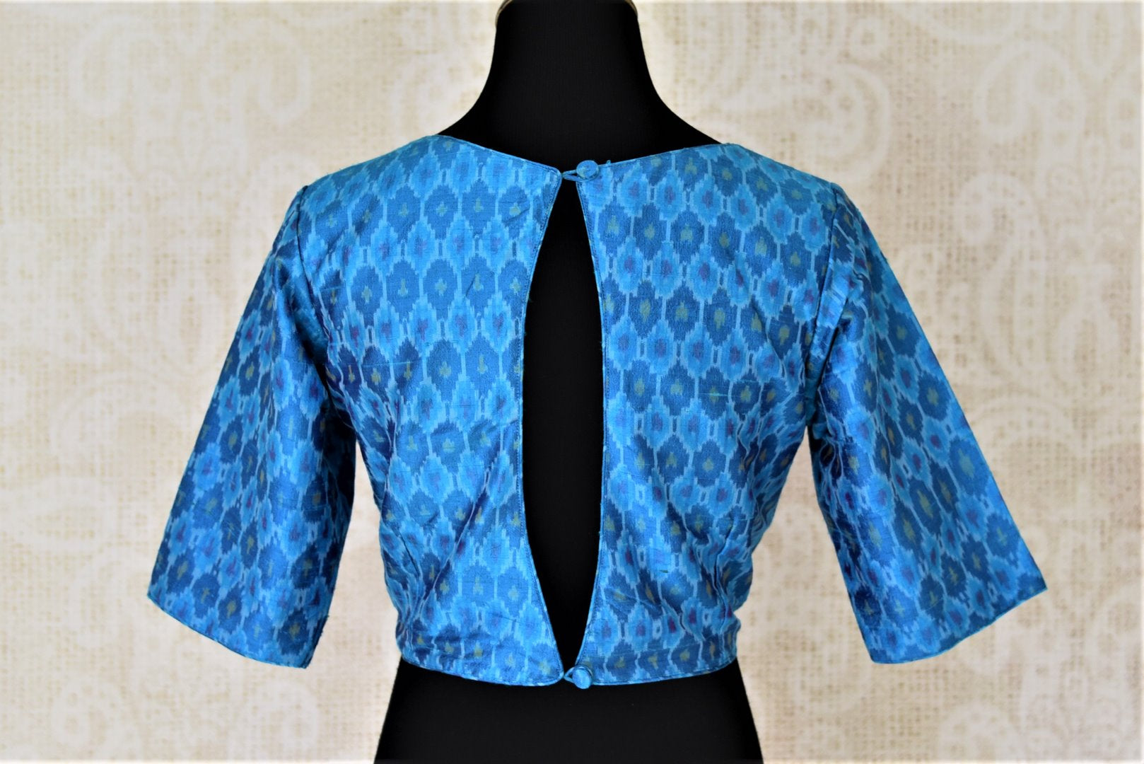 Shop stunning blue ikkat silk saree blouse online in USA with key-hole back. Shop beautiful designer sari blouses, readymade saree blouse in USA from Pure Elegance Indian fashion store in USA. Shop online now.-back