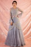 Buy gorgeous grey embroidered organza gown online in USA. Gown has fine silver embroidery work. It has net top and circular flounce sleeves. It has unique design. Be the talk of parties and weddings with exquisite designer gowns from Pure Elegance Indian clothing store in USA.Shop online now.-full view
