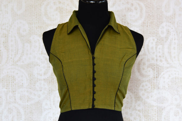 Buy green sleeveless cotton saree blouse online in USA. Choose from a range of exclusive designer saree blouses from Pure Elegance Indian Clothing Store in USA.-front
