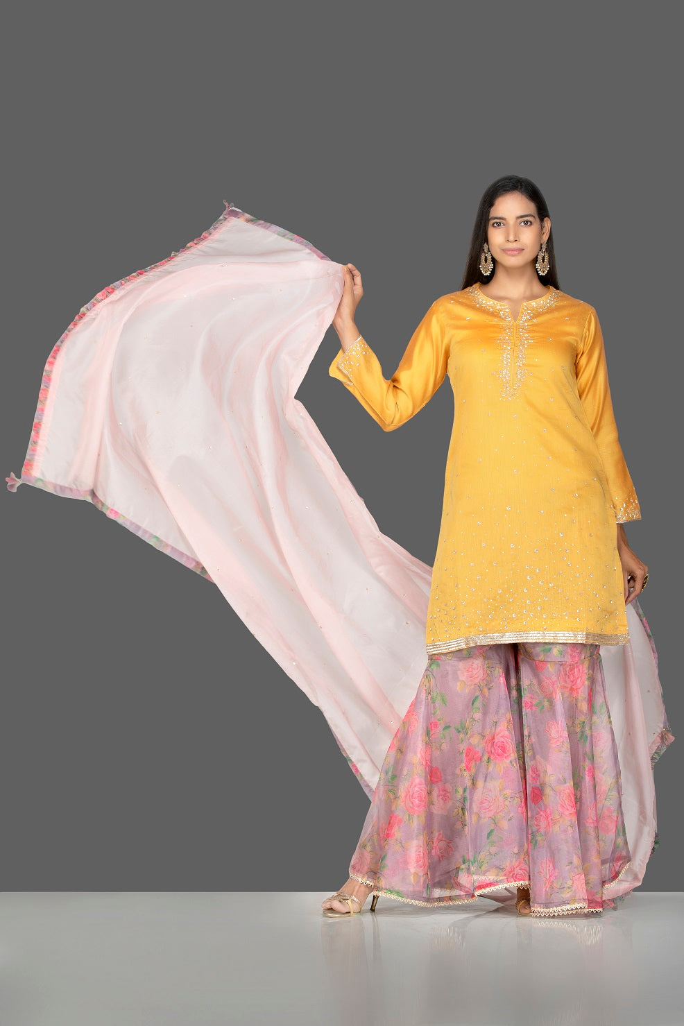 Buy gorgeous yellow embroidered suit online in USA with pink floral palazzo and pink dupatta. Flaunt ethnic fashion on weddings and festive occasions with latest designer lehengas, Indian dresses, traditional Anarkali suits from Pure Elegance Indian clothing store in USA.-full view